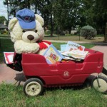 Loaded into his little red wagon, he was raring to go.